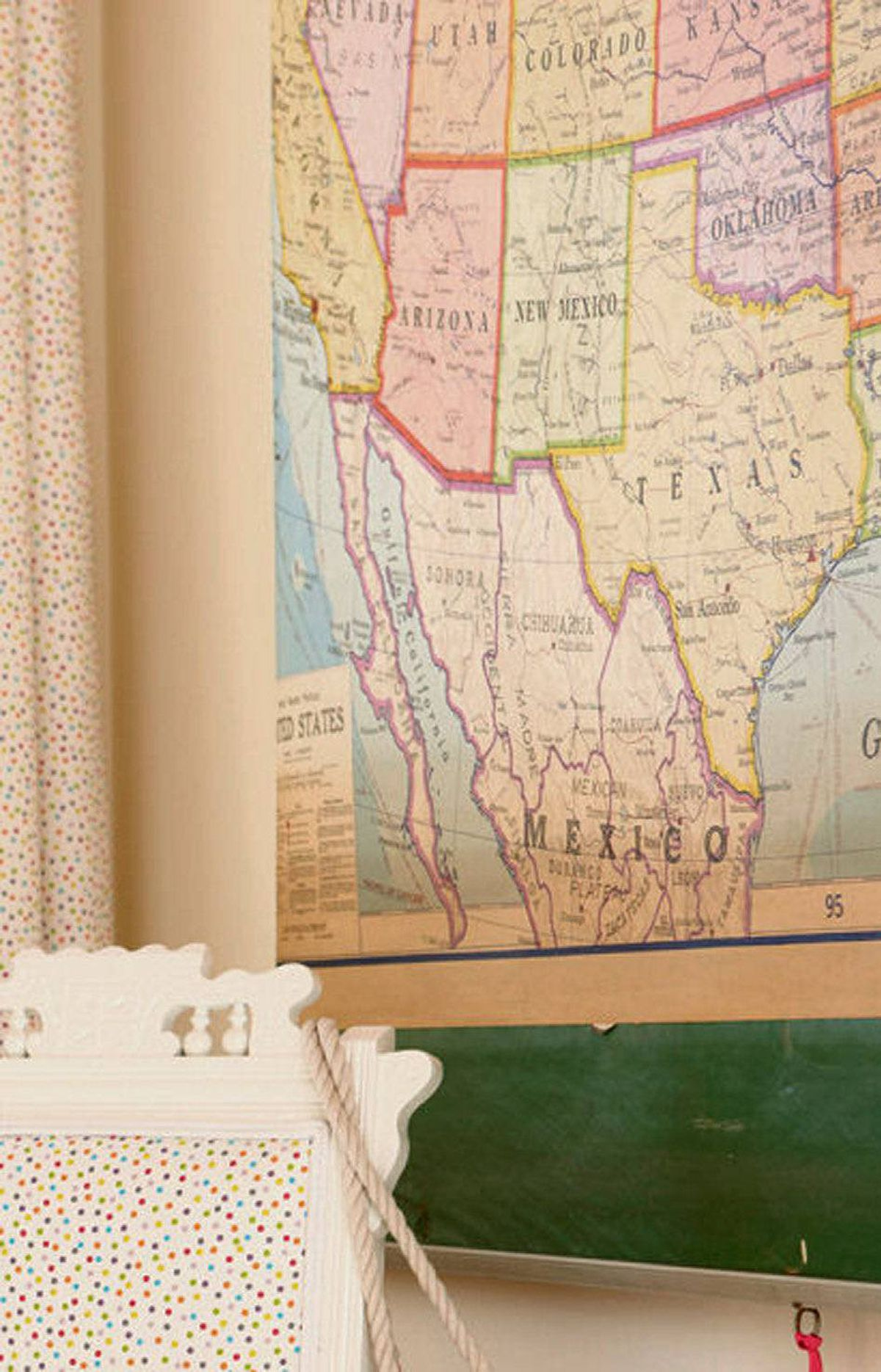 SCOUT FOR UNEXPECTED ART Looking for an inexpensive way to add colour, pattern and interest to your walls? Try an overscale vintage pull-down map, hung with its original roller mechanism intact, ties in nicely to the room's bright new colour scheme and provides a big-impact solution for less than $150.