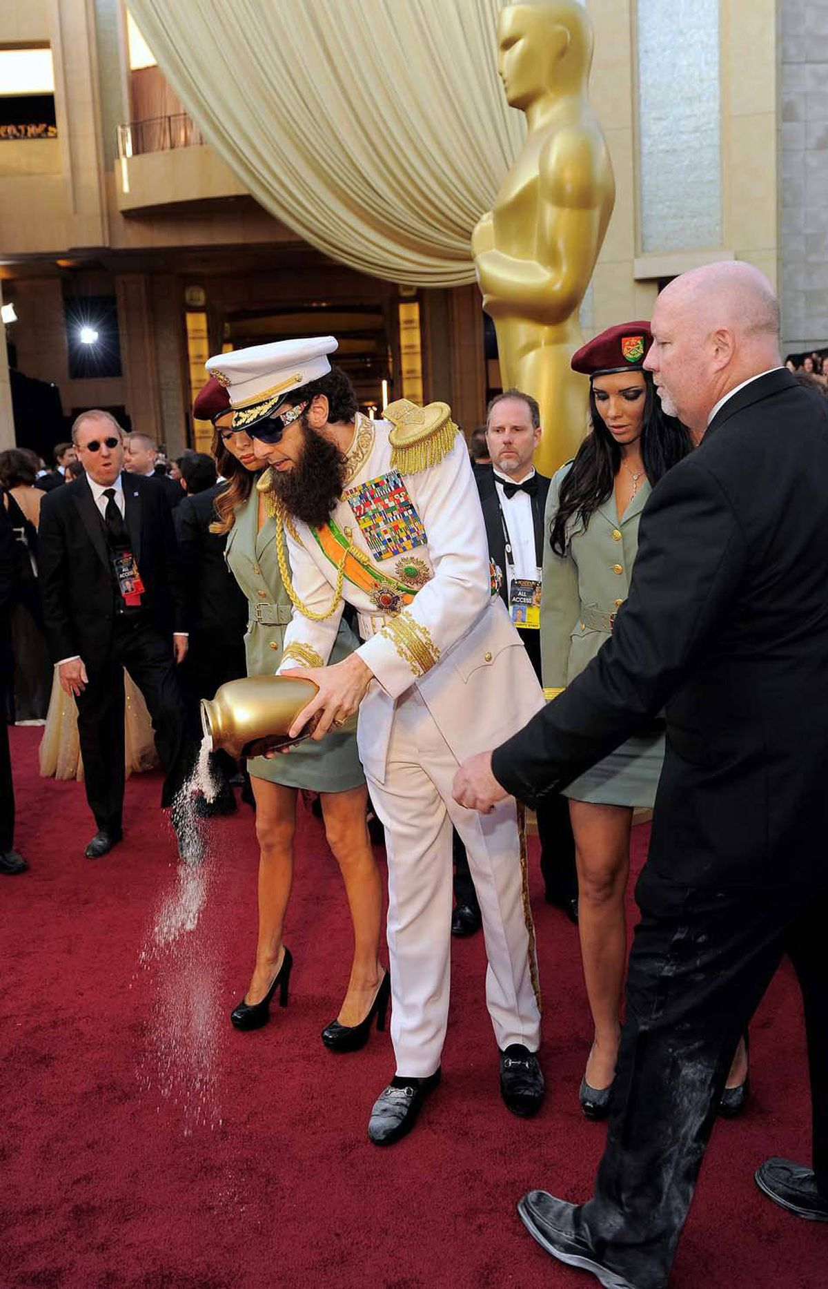 Later, Sacha Baron Cohen pretended to spill the ashes of Kim Jong-Il on the red carpet, causing one security guard to step in when he thought it was the cocaine for Vanity Fair after party.