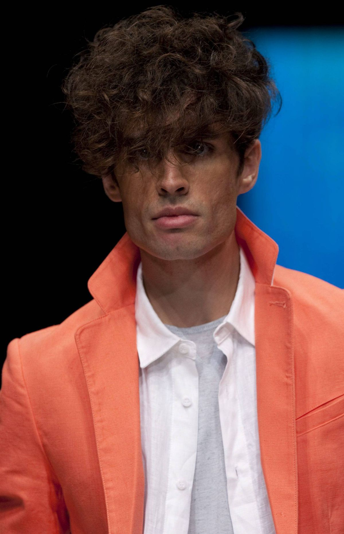 A sailboat with bikini-clad girls played backdrop to a catwalk of yacht-club-meets-prep-school linen blazers, nautical stripes and the week's best take on orange yet – coral.
