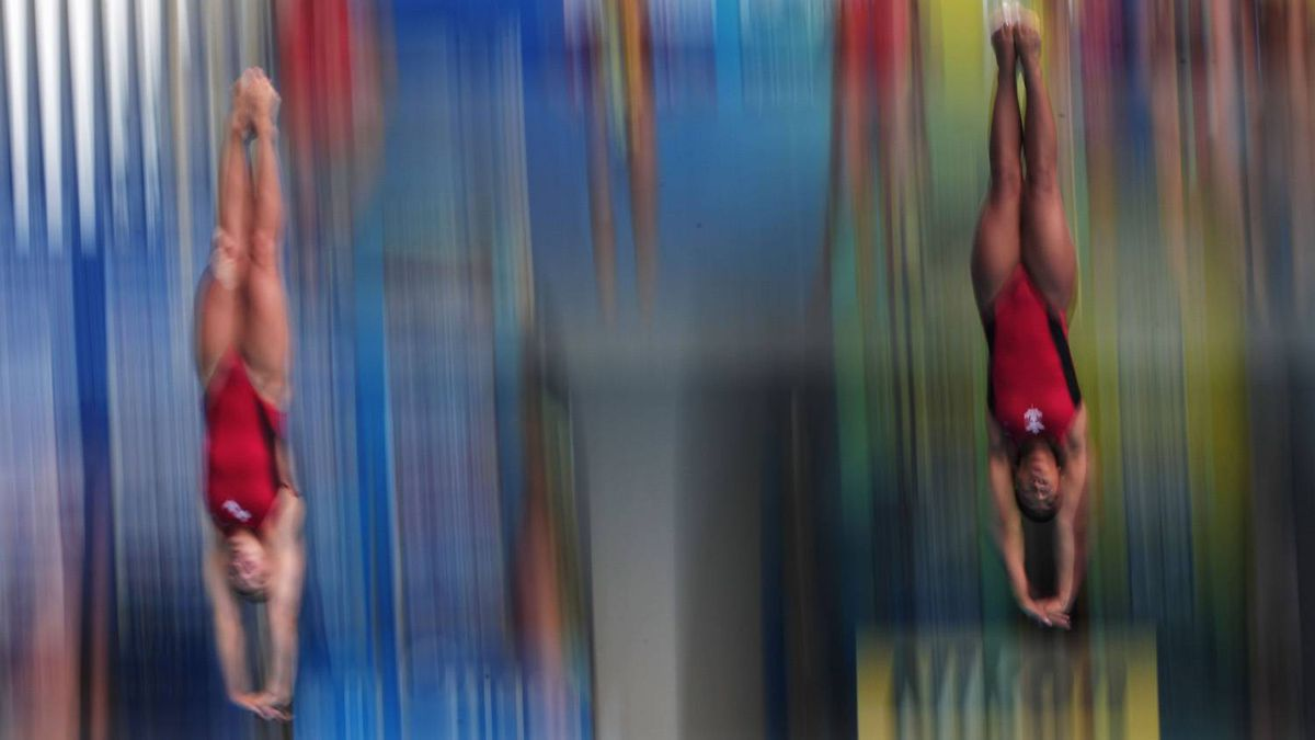 Emilie Heymans (L) and Jennifer Abel of Canada dive during a warm up session prior to the Women's 3m Springboard Synchro Final during Day One of the 14th FINA World Championships at the Oriental Sports Center on July 16, 2011 in Shanghai, China.