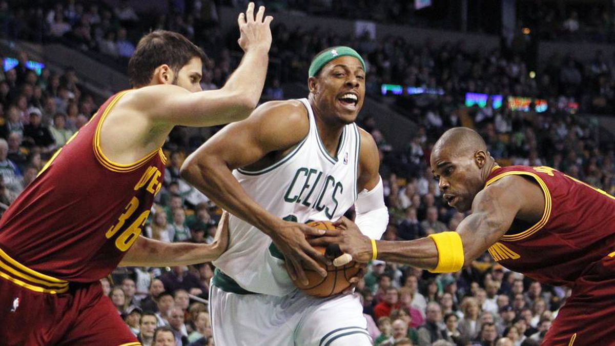 Boston Celtics' Paul Pierce, centre, drives between Cleveland Cavaliers' Omri Casspi, left, and Antawn Jamison during the first quarter of an NBA basketball game in Boston, Sunday.