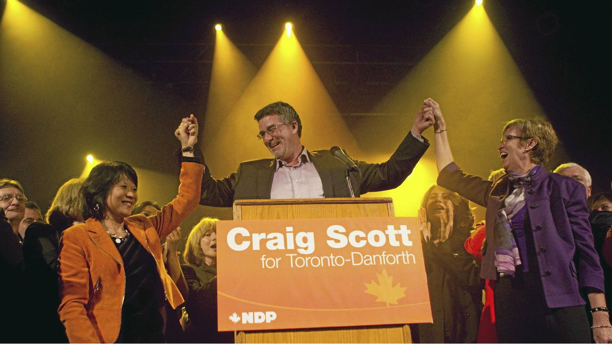 NDP's Craig Scott (centre) celebrates his victory in the Toronto-Danforth Federal By-Election with Olivia Chow (left) and Nycole Turmel in Toronto on Monday March 9, 2012. The seat was vacant after the death of former NDP Leader Jack Layton.