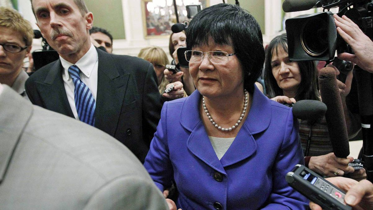 International Co-operation Minister Bev Oda is escorted past journalists after testifying before a Commons committee investigating contempt charges against her on March 18, 2011.