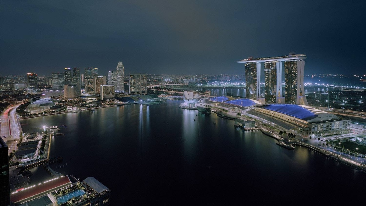 The southeast Asian city-state of Singapore, long renowned as an international financial centre with a busy port, now aims to become a top tourist destination. Reclaimed land along the waterfront has become the site of the gigantic Marina Bay Resort.