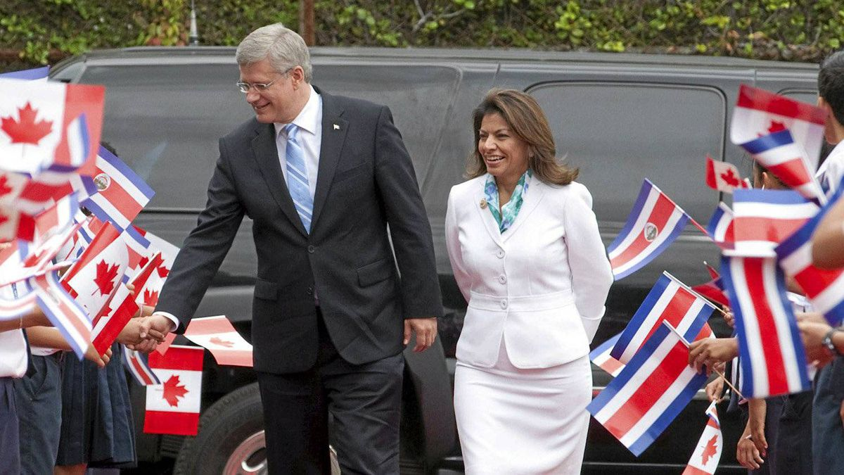 Canadian Prime Minister Stephen Harper walks with the President of Costa Rica Laura Chinchilla Miranda as he arrives at the Presidential palace in San Jose , Costa Rica, Aug. 11, 2011.
