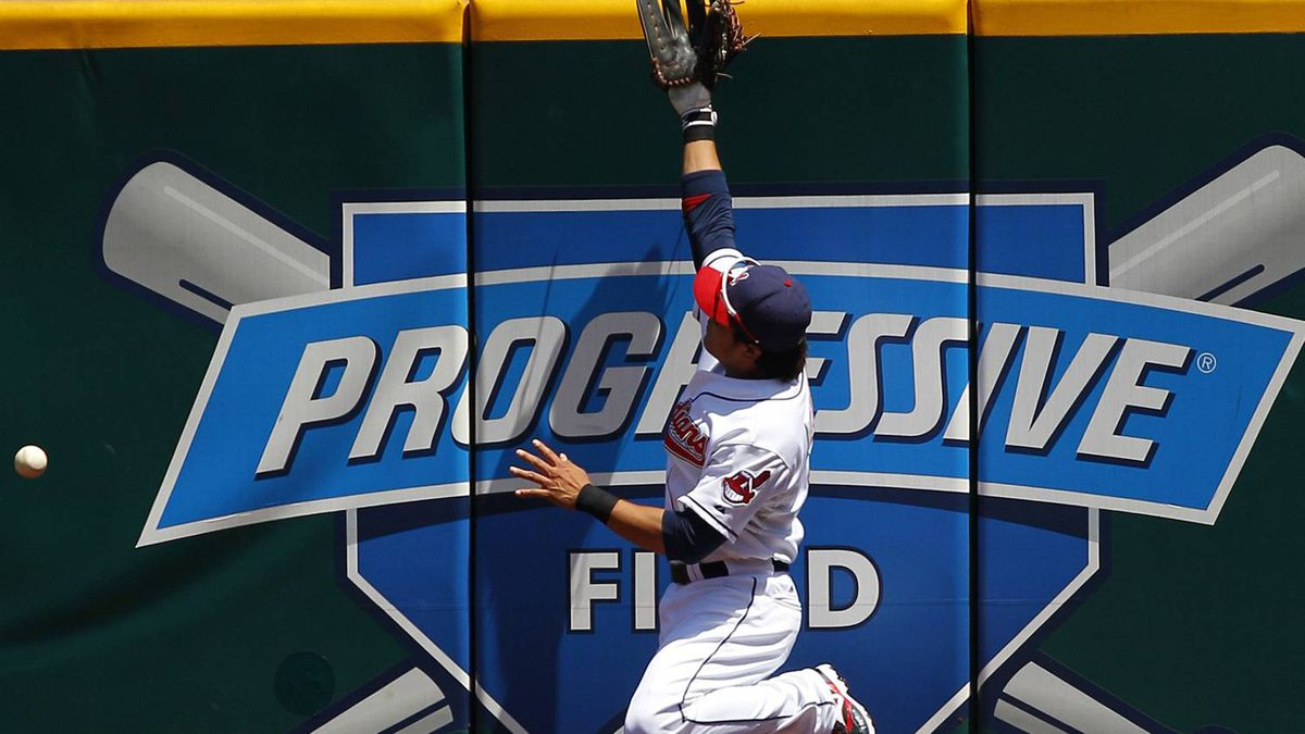 Cleveland Indians Shin-Soo Choo is unable to make a catch as he jumps against the wall after a ball hit by Toronto Blue Jays Adam Lind during the first inning of their MLB American League baseball game in Cleveland, Ohio July 1, 2010. REUTERS/Aaron Josefczyk