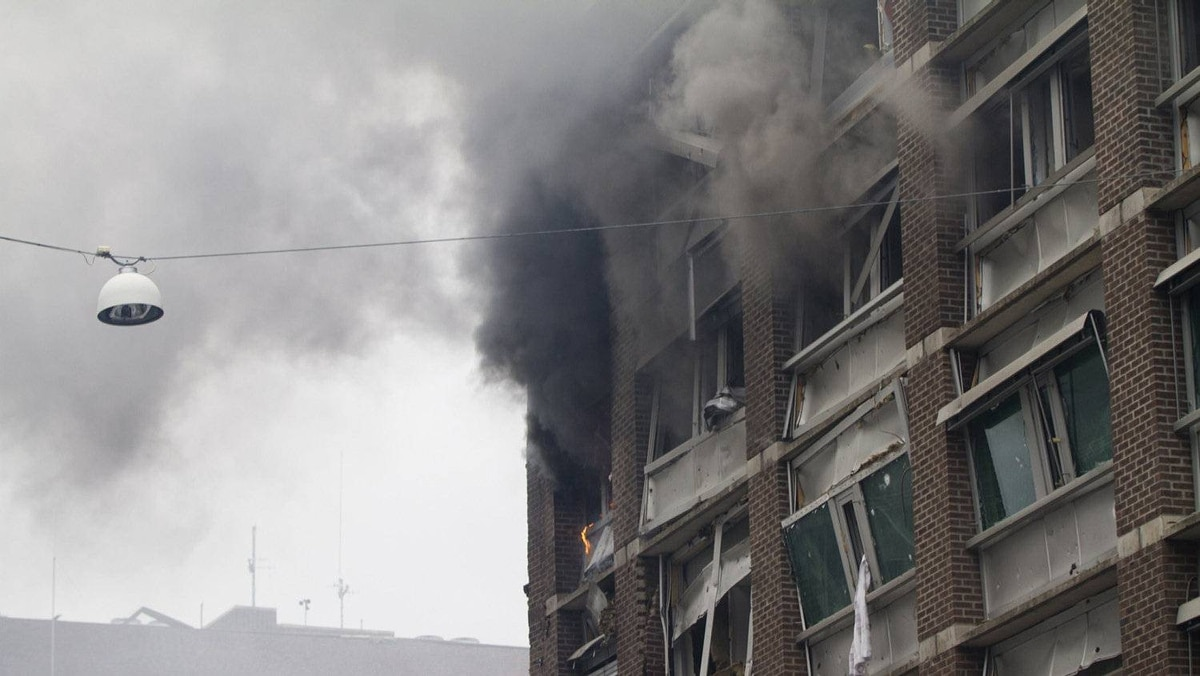 Smoke billows from a building at the site of the explosion that rocked central Oslo. The blast blew out most windows on the 17-storey building housing Stoltenberg's office, as well as nearby ministries including the oil ministry, which was on fire.