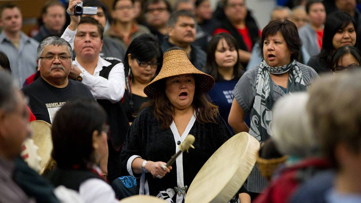 A woman from the Haisla First Nation beats a drum during a ceremony to open hearings for the Enbridge Northern Gateway Project in Kitimaat Village, B.C., on Tuesday January 10, 2012.