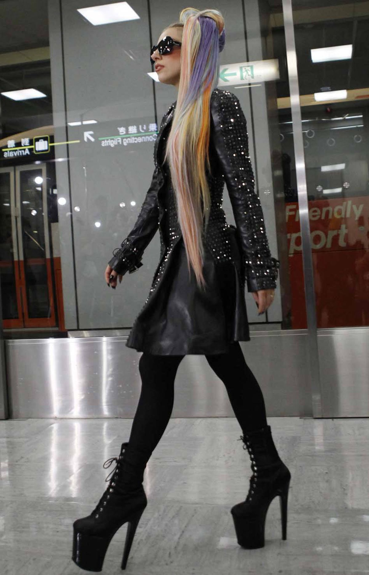 Singer Lady Gaga arrives at Narita Airport outside Tokyo on Tuesday wearing her comfy airplane clothes.