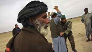 Afghan Army soldiers search civilians for weapons in March, 2007 outside of Lashkar Gah in the Afghan's restive Helmand province.
