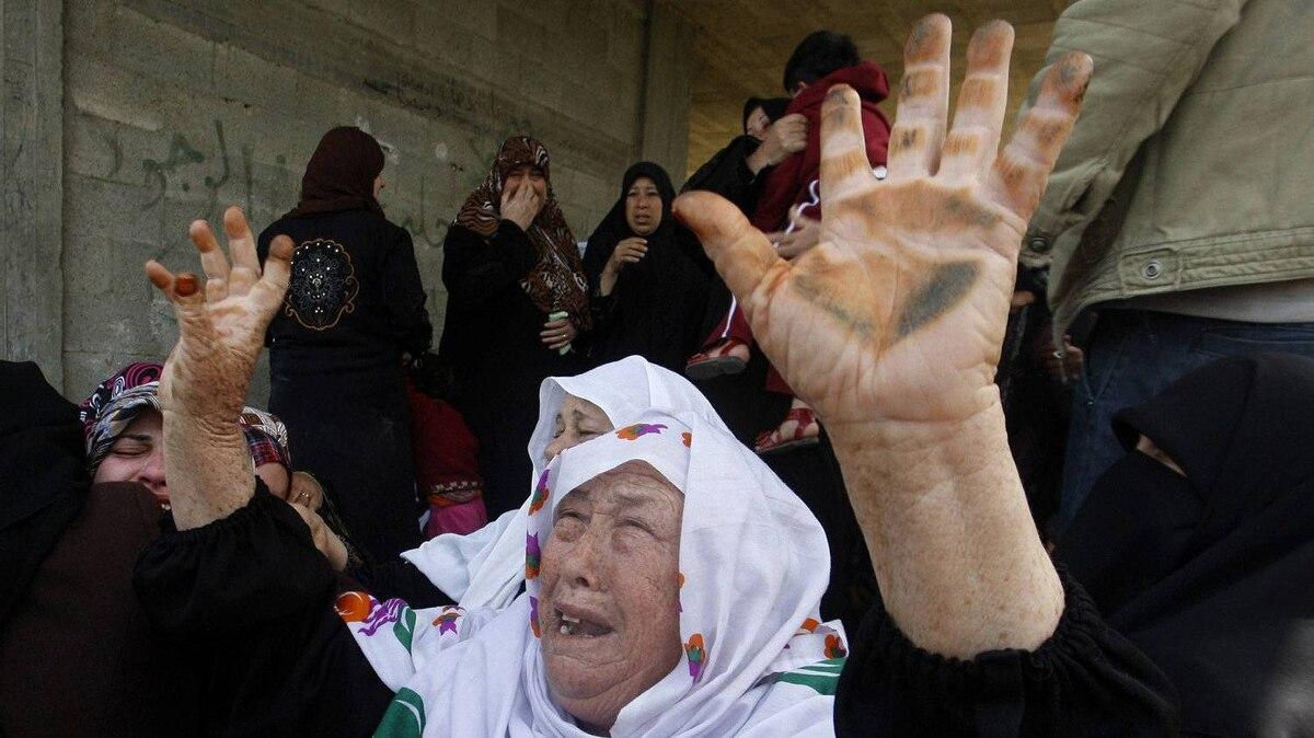 Palestinians women react during the funeral of 12 year old Ayoub Assalya killed in an Israeli airstrike in Jabaliya Refugee Camp, in Gaza Strip, Sunday, March 11, 2012. The worst round of violence in more than a year between Israel and Gaza Strip Palestinians deepened Sunday with deadly Israeli airstrikes and a barrage of rockets fired into the Jewish state