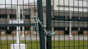 Security fences surround ocomotive maker Electro-Motive facility in London, Ont., Sunday, Jan. 1, 2012, in anticipation of a work stoppage. The Canadian Auto Workers union says it is holding off on a strike in the hope of reviving contract negotations with Caterpillar Inc.