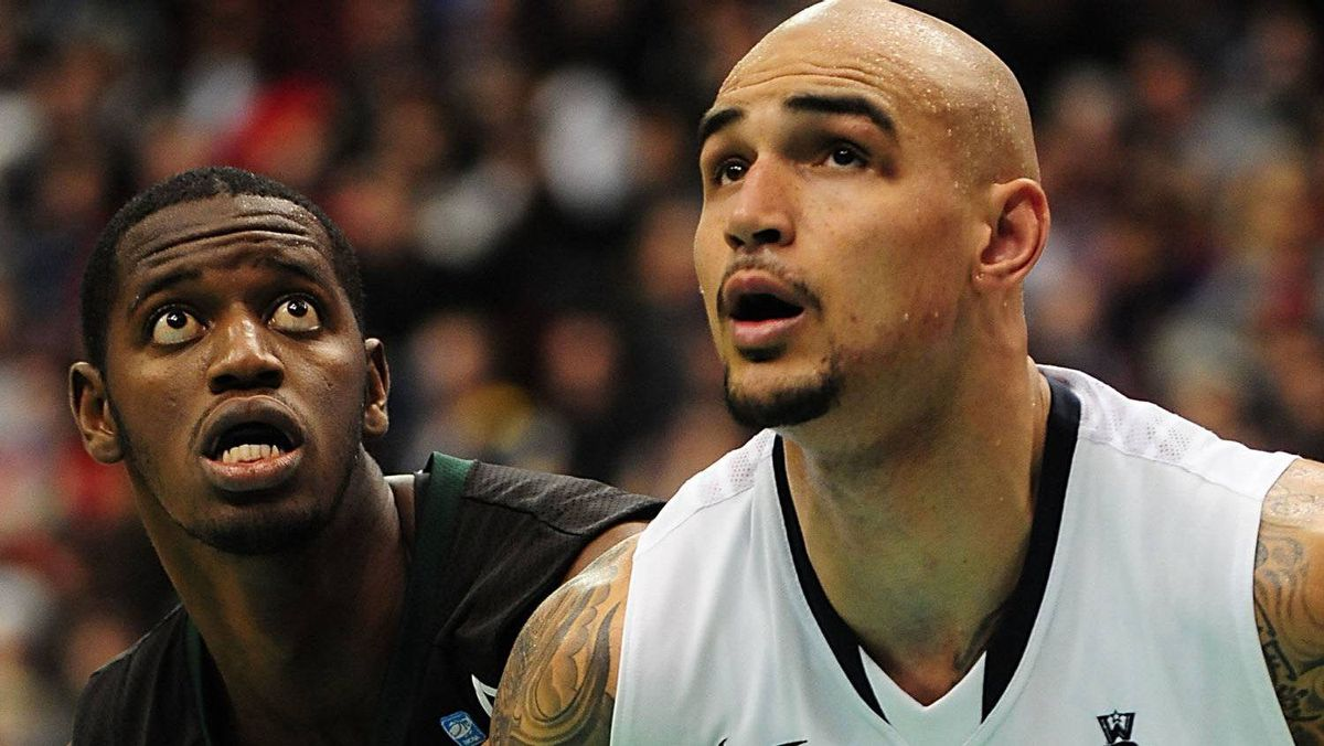 Hawaii Warriors centre Vander Joaquim (15) and Gonzaga Bulldogs centre Robert Sacre (00) watch a shot during the second half at Rogers Arena. The Gonzaga Bulldogs won 73-54. Anne-Marie Sorvin-US PRESSWIRE