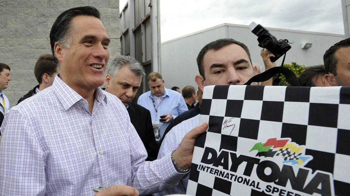 Republican presidential candidate, former Massachusetts Gov. Mitt Romney signs autographs for fans as he visits Daytona International Speedway before the NASCAR Daytona 500 Sprint Cup series auto race in Daytona Beach, Fla., Sunday, Feb. 26, 2012.