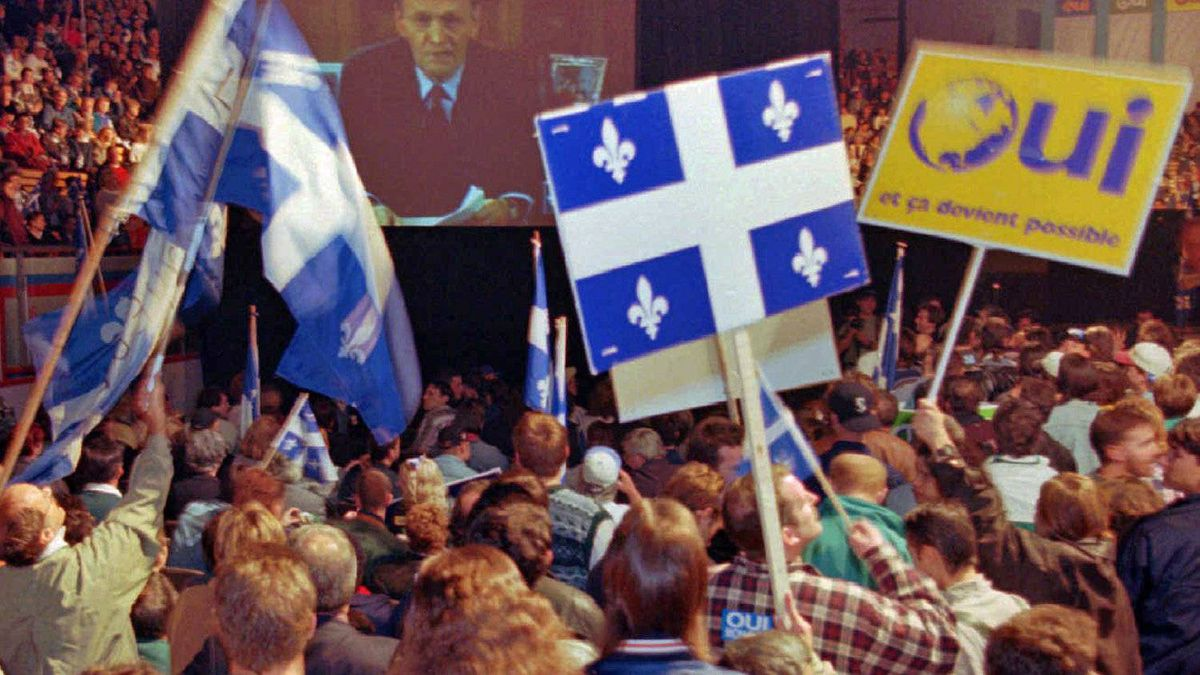 A crowd of Yes supporters wave Quebec flags at a Montreal rally during a live television address by Prime Minister Jean Chretien on Oct. 25, 1995.