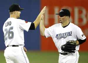 Toronto Blue Jays players Adam Lind and Travis Snider, right, celebrate their win against the Baltimore Orioles in Toronto, September 21, 2009.