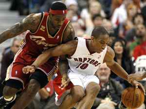 Toronto Raptors forward Demar DeRozan protects the ball against Cleveland Cavaliers forward LeBron James (L) during the first half of their NBA basketball game in Toronto February 26, 2010. REUTERS/ Mike Cassese