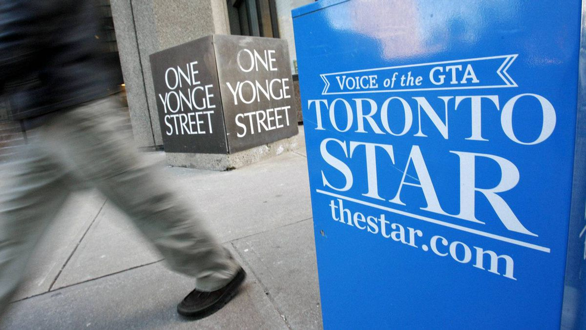 A pedestrian walks past a Toronto Star box in front of the newspaper's offices on Jan. 18, 2008.