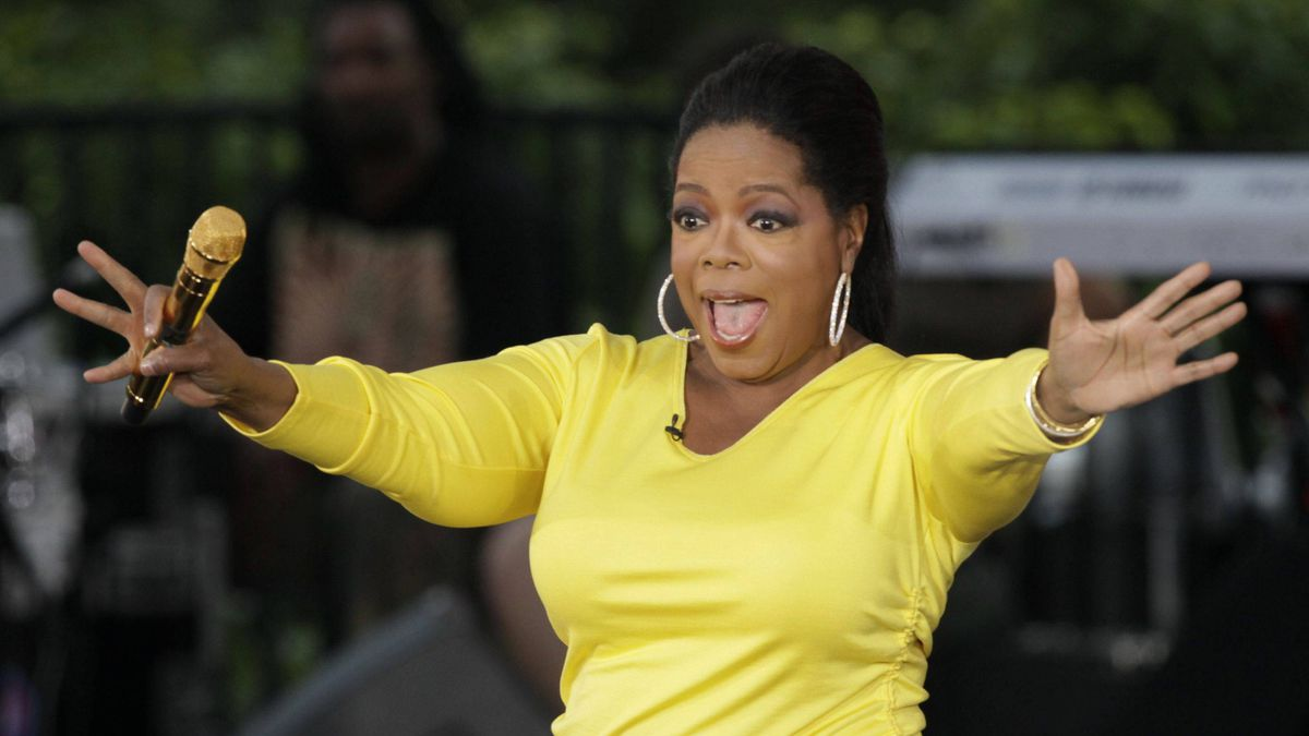 "This Sept. 8, 2009 file photo shows, Oprah Winfrey waves to her fans in Chicago while taping an episode of ""The Oprah Winfrey Show"" on a three-block stretch of Chicago's Michigan Avenue near the Chicago River, to celebrate the start of the 24th season of her show."