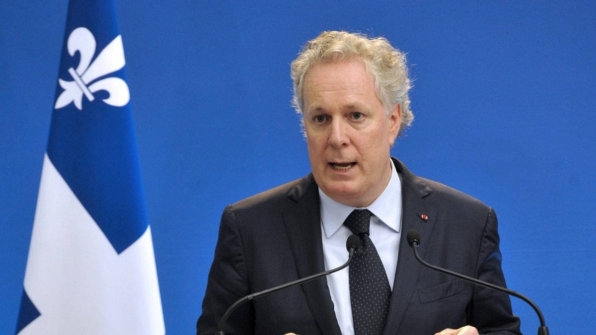 The Premier of Quebec Jean Charest speaks during a press conference at the Hotel Matignon in Paris, on October 5, 2011.