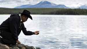 A member of the Xeni Gwet'in First Nation stands at the edge of Fish Lake in B.C. on Sept. 10, 2010.