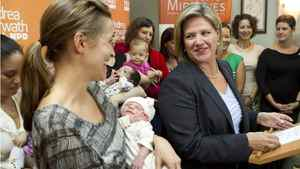 Ontario NDP leader Andrea Horwath stands with new mothers and their babies at a birthing centre in Toronto during her election campaign on Wednesday September 21, 2011.