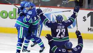 Vancouver Canucks celebrate their tying goal with 13.6 seconds in regulation in the third period against San Jose Sharks of game five of the NHL Western Conference final in Stanley Cup playoff hockey action in Vancouver May 24, 2011. (John Lehmann/The Globe and Mail)