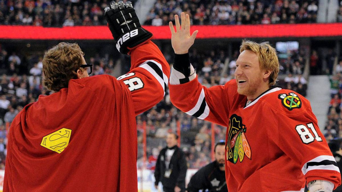 Chicago Blackhawks Patrick Kane wears a Superman cape as he gets a high-five from teammate Marian Hossa as they take part in the Breakaway Challenge during the NHL All-Star skills competition in Ottawa on Saturday, January 28, 2012. THE CANADIAN PRESS/Sean Kilpatrick