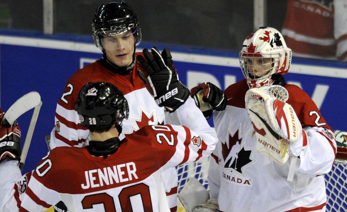 Canada's goalie Mark Visentin, right, is congratulated by teammates Jamie Oleksiak and Boone Jenner after they defeated Denmark at the 2012 IIHF U20 World Junior Hockey Championships in Edmonton, Alberta, December 29, 2011.