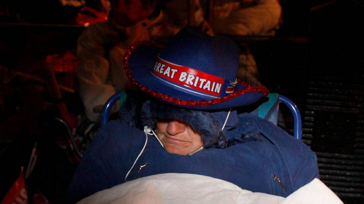 Royal enthusiasts sleep close to Westminster Abbey, along the Royal Wedding route in London Friday, April, 29, 2011.