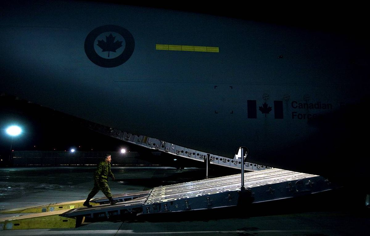 Military personnel prepare to load supplies on a CC-177 Globemaster on the tarmac at CFB Trenton for a Disaster Assistance Response Team ( DART) humanitarian mission to earthquake ravaged Haiti on Wednesday.