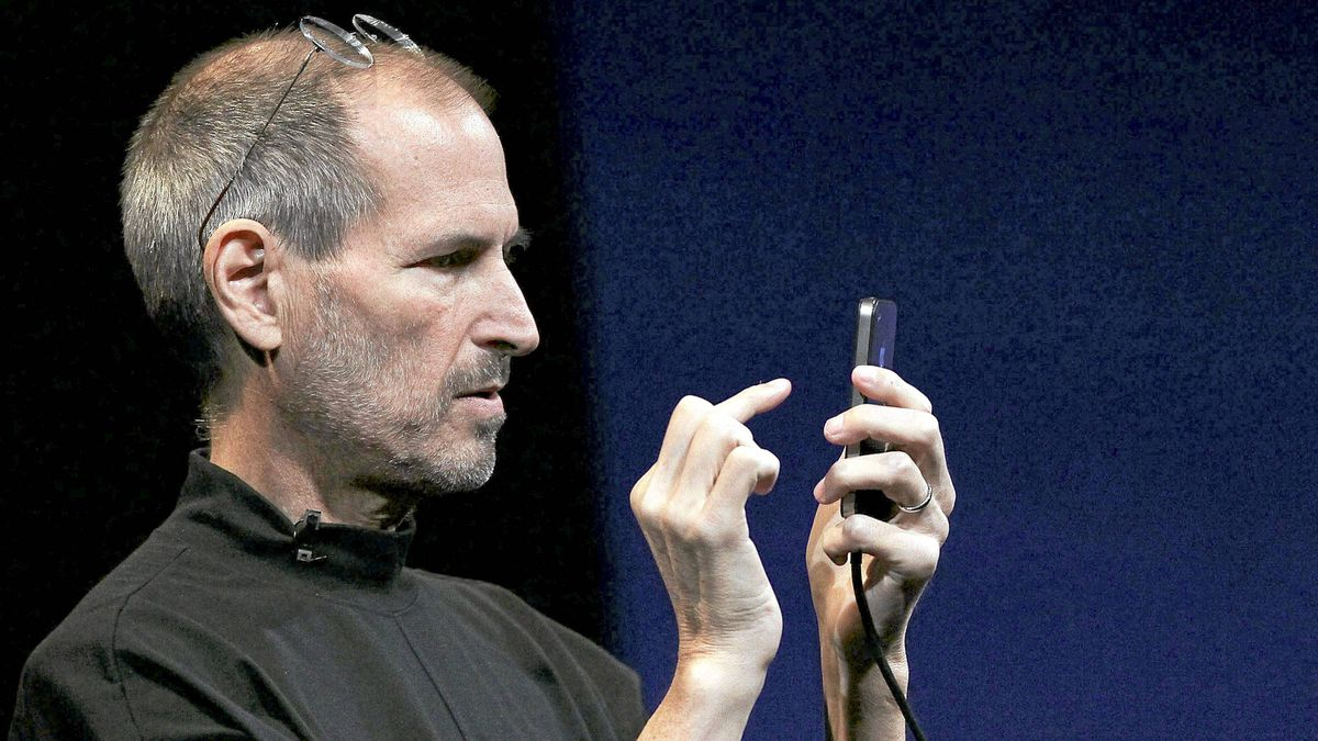 Apple CEO Steve Jobs demonstrates the new iPhone 4 as he delivers the opening keynote address at the 2010 Apple World Wide Developers conference June 7, 2010 in San Francisco.