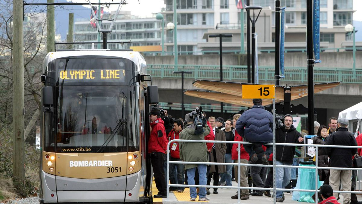 Passengers board a streetcar near the Olympic Village Canada Line Station in Vancouver. Two streetcars, on loan from the Brussels Transport Co., will provide free rides from the Olympic Village Canada Line Station to Granville Island. Darryl Dyck/ The Canadian Press