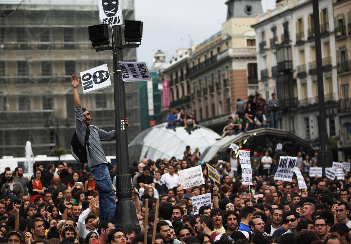 Supporters of a movement protesting against the ongoing financial crisis, take part in a demonstration at Madrid's Puerta del Sol.