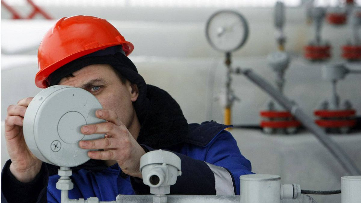 A Gazprom technician works on a pressure gauge at the gas export monopoly's Sudzha compressor station. Gazprom supplies about a quarter of Europe's gas.