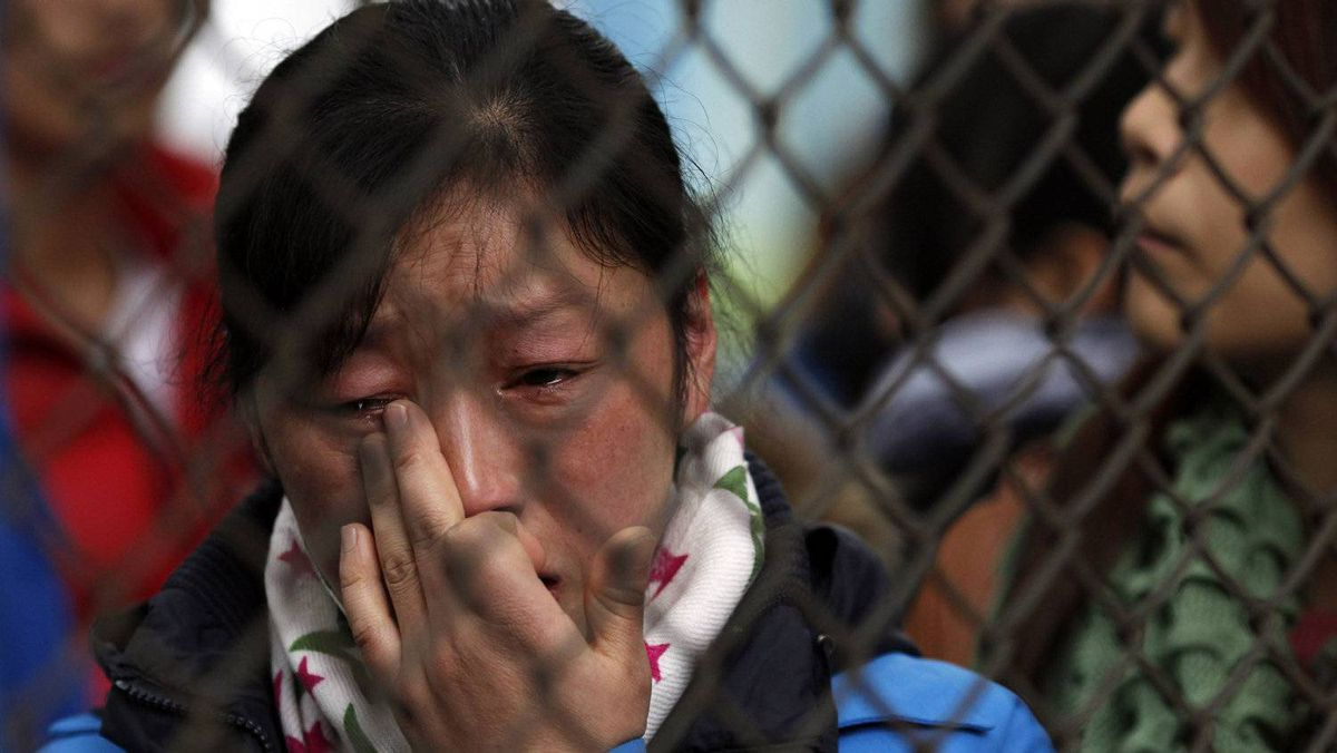 A striking factory worker from electronics manufacturerHi-P International in suburban Shanghai cries after police entered the factory with trucks to remove heavy machinery.