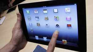 In this March 7, 2012 file photo, a new Apple iPad is on display during an Apple event in San Francisco.