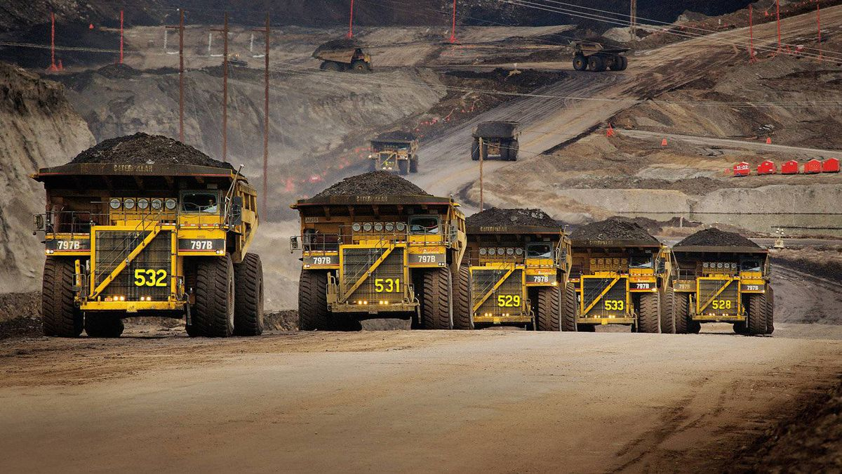 Caterpillar trucks working in the oil sands in Alberta, Canada.