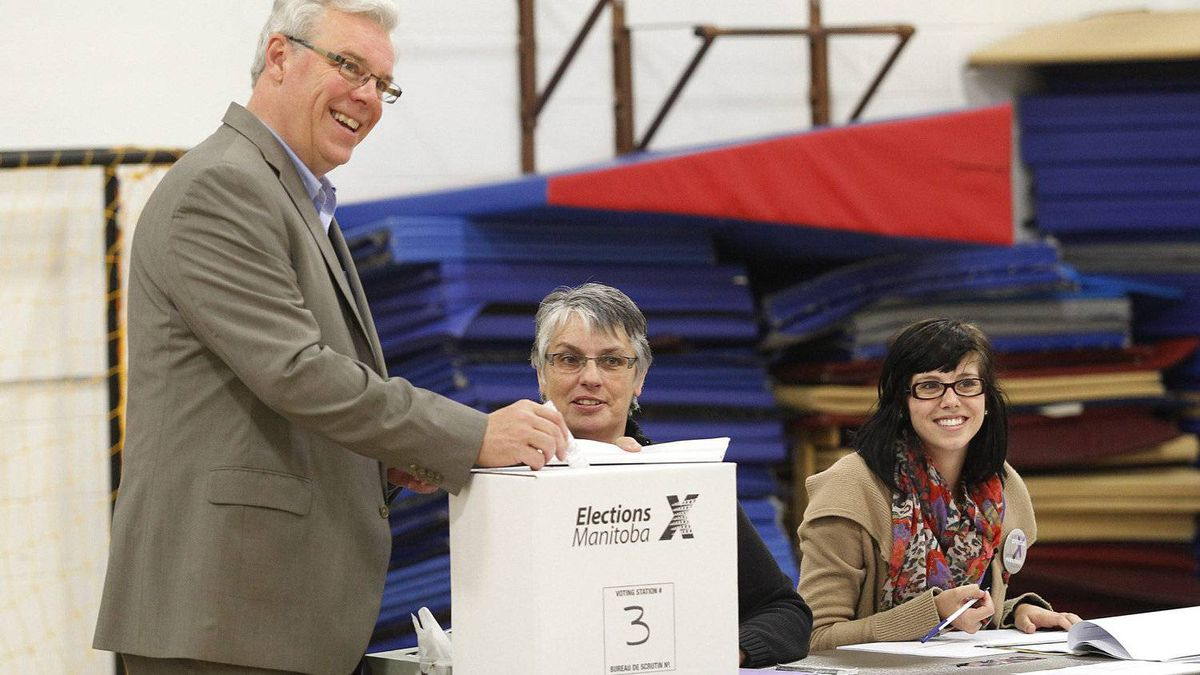 Manitoba Premier Greg Selinger casts his ballot in the Manitoba election in Winnipeg, Tuesday, October 4, 2011.