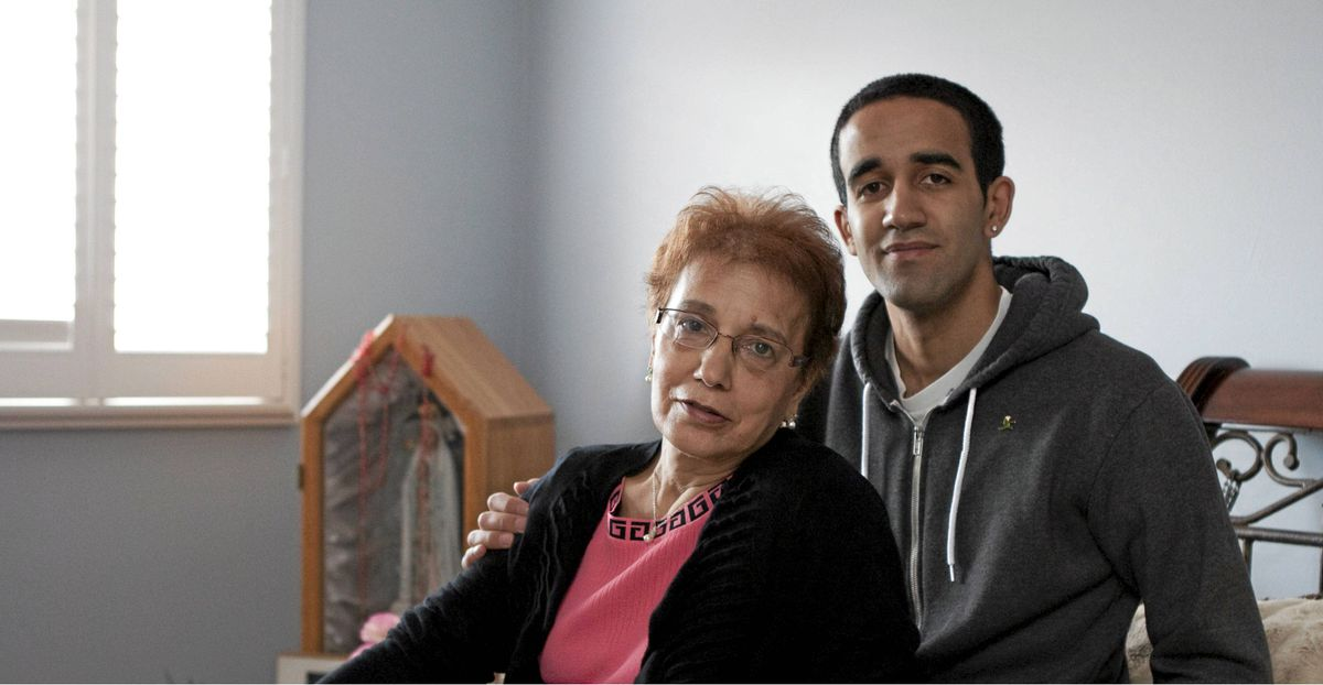 Lucia Andrade sits with her son Michael in their home in Brampton, Ont., on Thursday, May 10, 2012. Michael posted a story about his mother's need for a liver transplant online and eventually found a donor.