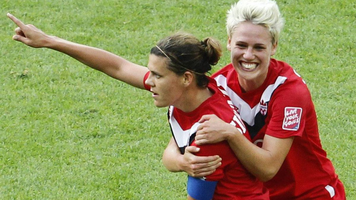 Canada's Christine Sinclair, left, is congratulated by her teammate Sophie Schmidt after scoring their side's first goal during the group A match between Germany and Canada at the Women?s Soccer World Cup in Berlin, Germany, Sunday, June 26, 2011. (AP Photo/Markus Schreiber)