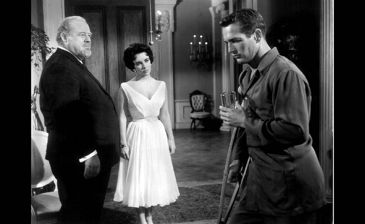 "From left, Burl Ives, Elizabeth Taylor and Paul Newman are seen in this file photograph from the 1958 film ""Cat on a Hot Tin Roof."""