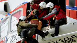 An elderly person is rescued by helicopter from the roof of an elementary school after an earthquake and tsunami in Sendai, northeastern Japan March 12, 2011