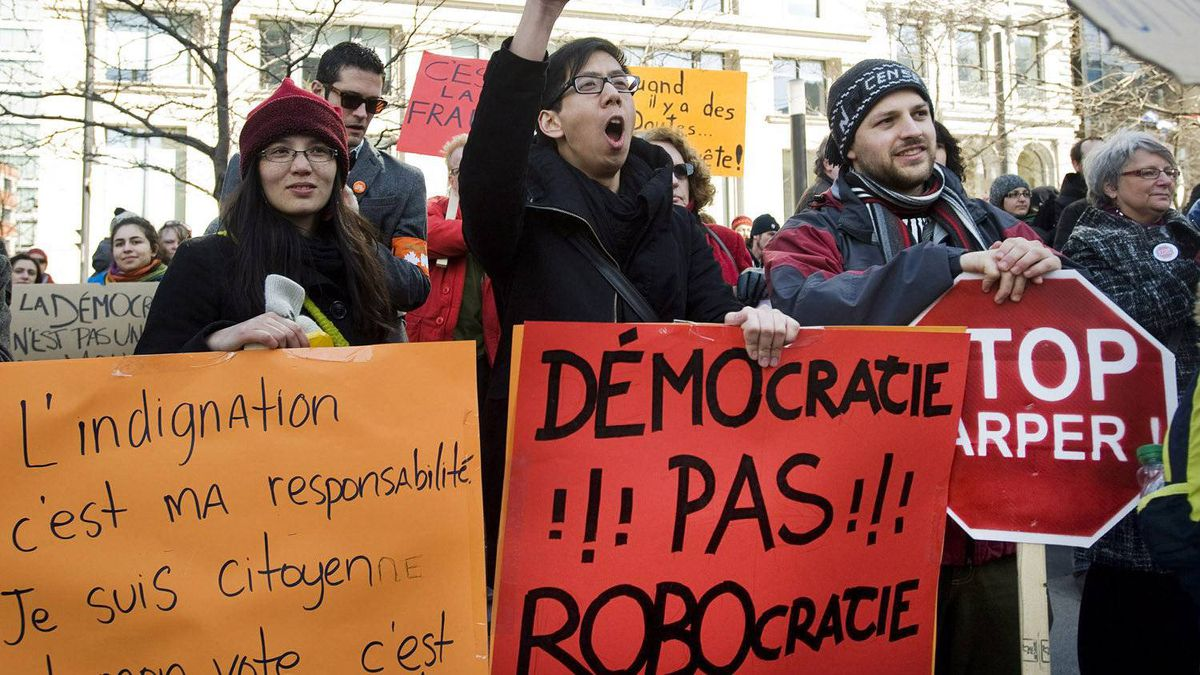 Demonstrators gather in Montreal, Sunday, March 11, 2012, protesting the 'Robocall' election fraud scandal.