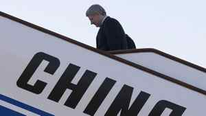 Canadian Prime Minister Stephen Harper boards his plane as he leaves Beijing, China Friday, Feb.10, 2012. The vast majority of foreign takeovers from China — but not all — pose no national security threat to Canada, says a new report that proposes Ottawa apply a three-step test to determine what is in the country's interest.