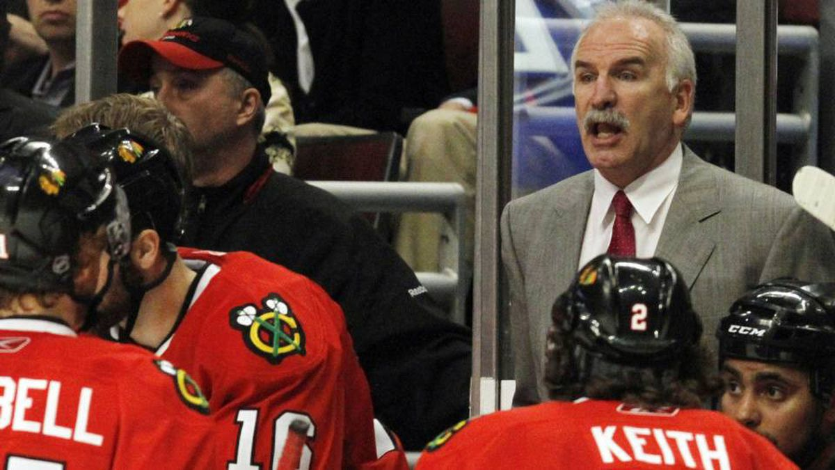 Chicago Blackhawks head coach Joel Quenneville talks to his players during the third period of Game 5 of an NHL hockey Western Conference second-round playoff series against the Vancouver Canucks Sunday, May 9, 2010, in Chicago. The Canucks won 4-1