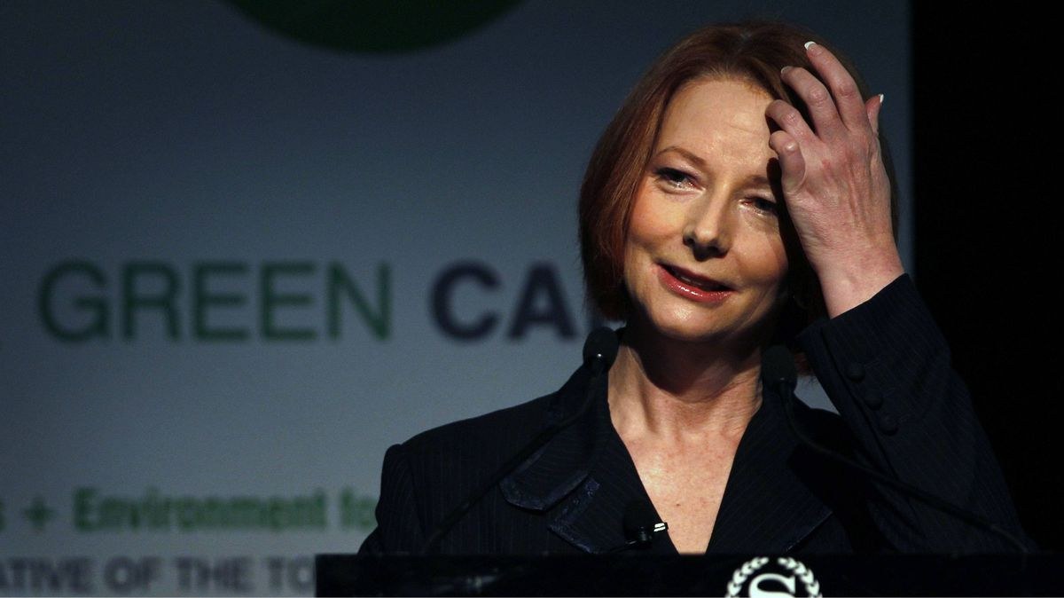 """Australia's Prime Minister Julia Gillard pauses during an address to """"The Long Carbon Journey"""" forum in Sydney July 18, 2011."""