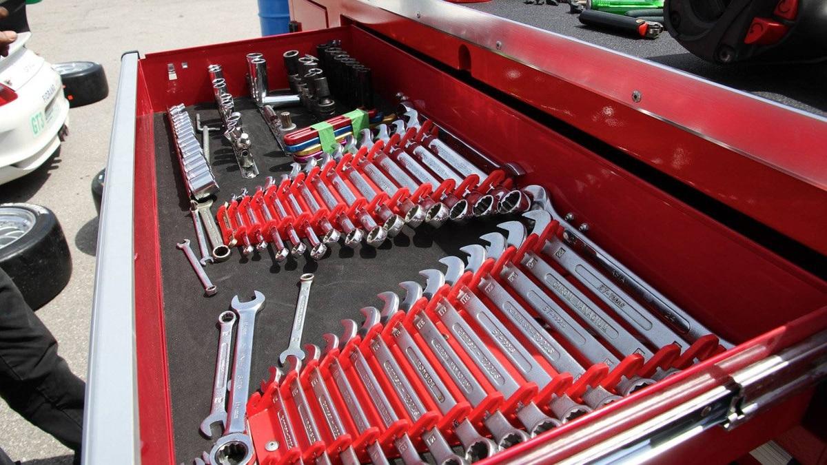 Race mechanics keep their tools organized for rapid access.