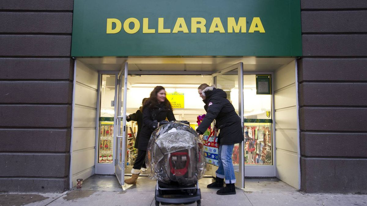 Shares of Dollarama Inc. gained 4 per cent after the discount retail announced it was raising its dividend and said quarterly profit soared 40 per cent on sales growth of 15 per cent. Customers shop at the Dollarama discount store location at Spadina Ave and Adelaide St. West in Toronto, Ont. Dec. 7/2011.