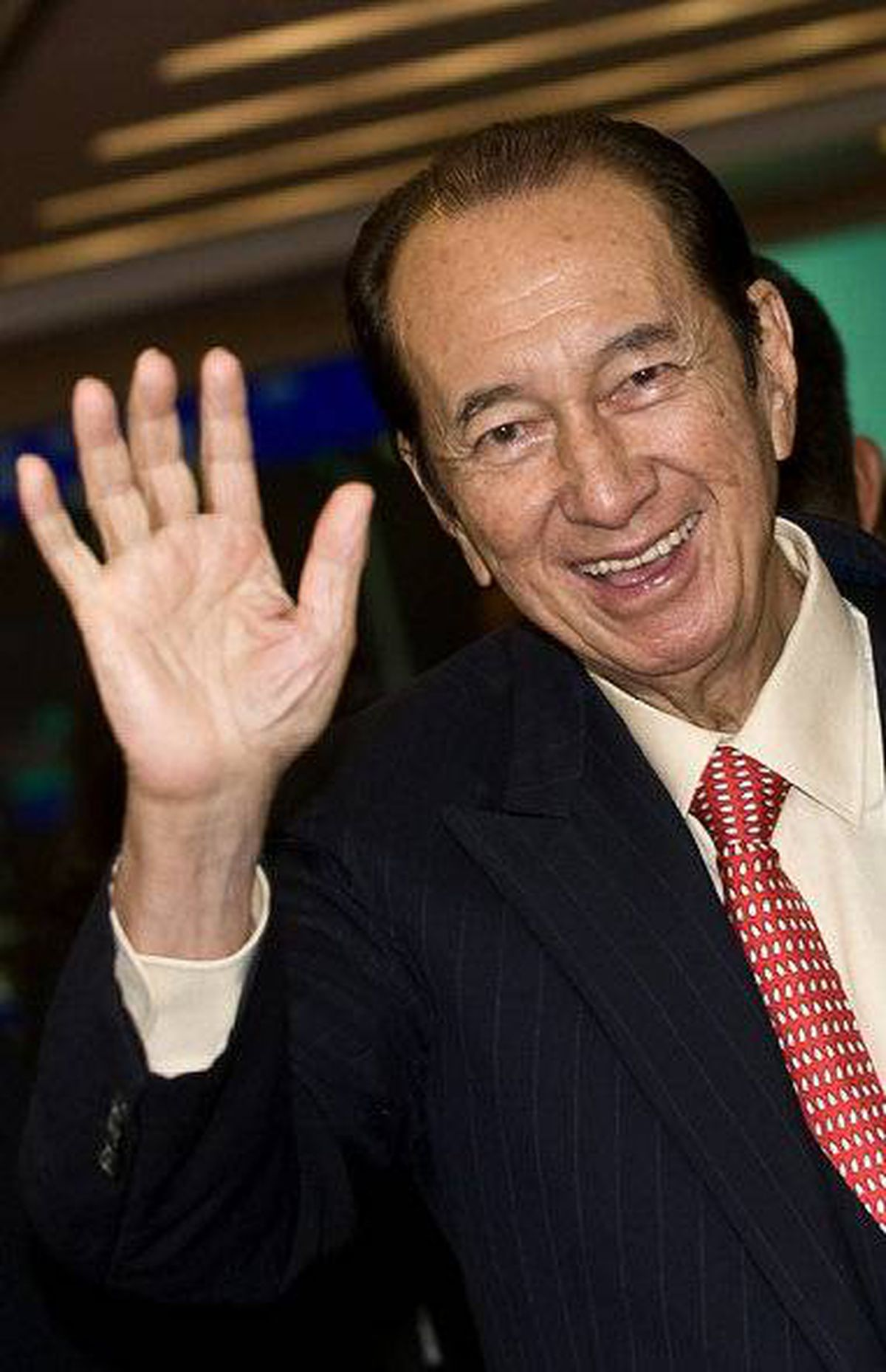 "file photo taken on July 16, 2008 shows Macau tycoon Stanley Ho waving during the listing ceremony of his part-owned company SJM Holdings Limited in Hong Kong. Macau tycoon Stanley Ho said on television on January 26, 2011 that a brawl with relatives whom he accused of stealing his $3.1-billion (U.S.) empre was ""resolved""."